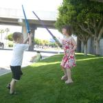 Liam & Saffy practicing their lightsaber moves while waiting to enter