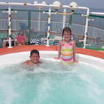 Saffy and her beau Andrew enjoy the hot tub on the way home