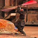 Darth Maul shows his saber skills but is quickly felled by Indy's bullet