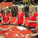 Booth babes learning to play Cryptozoic games